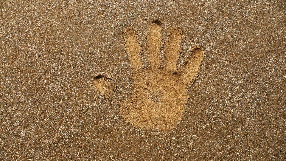 Kids Handprint in sand Opens in new window